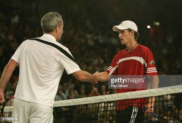 John McEnroe of USA shakes hands with Andrew Murray of Great Britain after his victory against Andrew Murray of Great Britain during the first round...