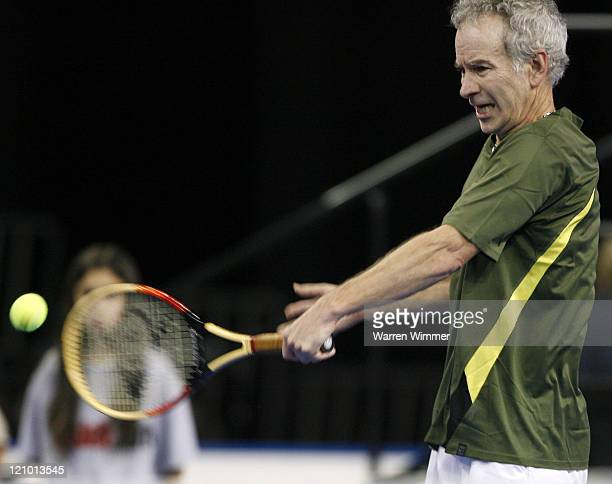 John McEnroe participates in exhibition play at the Mercedes Benz Classic Tennis Tour at Chicago's newest sports venue, The Sears Centre Arena,...