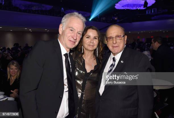 John McEnroe Patty Smyth and Clive Davis pose during the Songwriters Hall of Fame 49th Annual Induction and Awards Dinner at New York Marriott...
