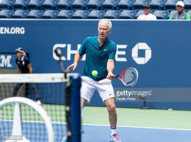 John McEnroe play exhibition match during New Louis Armstrong stadium dedication at USTA Billie Jean King National Tennis Center
