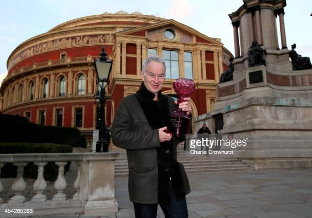 John McEnroe poses for a photo with his trophy outside The Royal Albert Hall after winning the mens legends final during the singles final match...