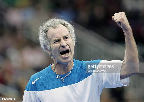 John McEnroe pumps his fist after scoring a point against Jim Courier during the Serving for Tsunami Relief tennis match at Toyota Center in Houston...