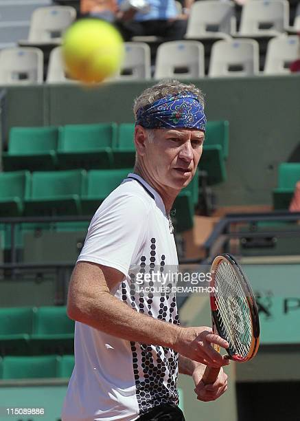 US John McEnroe reacts as he plays with Ecuador' Andres Gomez vs Sweden's Mats Wilander and Mikael Pernfors during legends over 45 double at the...