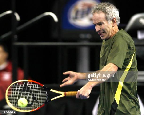 John McEnroe shows the crowd that he still has game during the exhibition match against Jim Courier at the Mercedes Benz Classic Tennis Tour played...