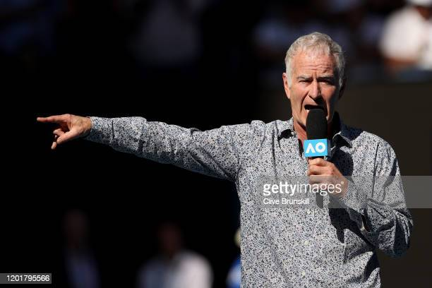 John McEnroe speaks on court after the Men's Singles third round match between Rafael Nadal of Spain and Pablo Carreno Busta of Spain on day six of...
