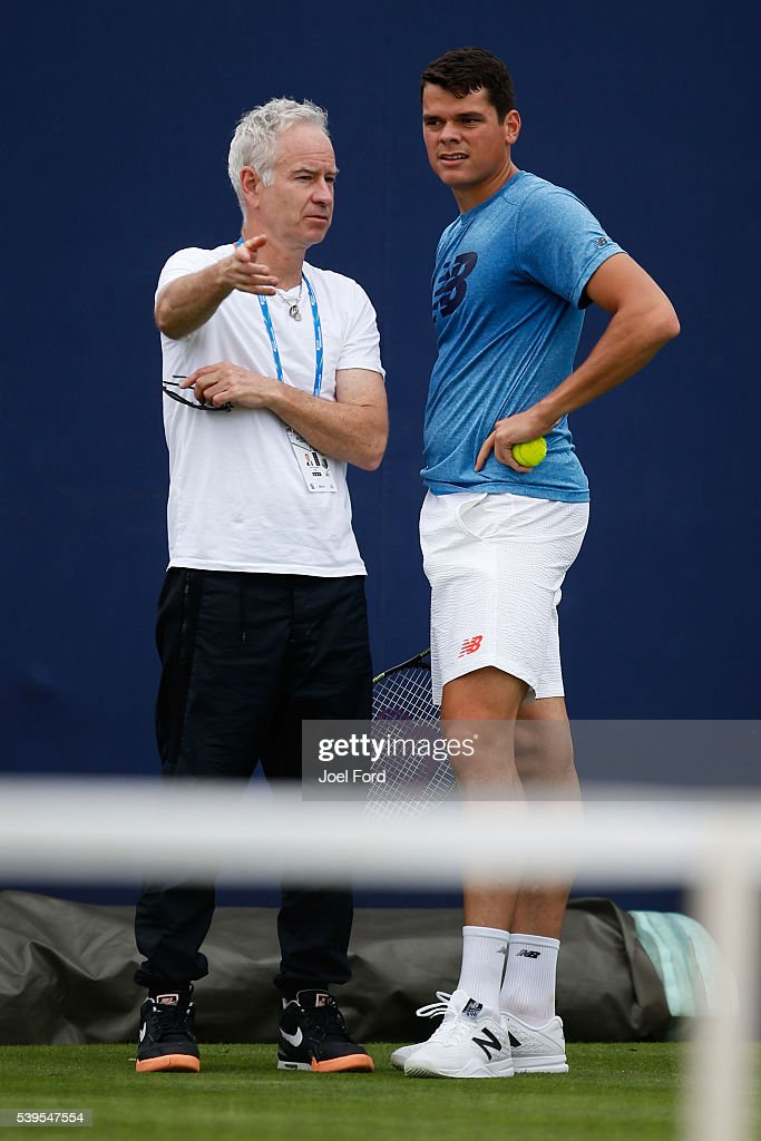 John McEnroe (L) speaks to Milos Raonic during a practice session at the Aegon Championships at Queens Club on June 12, 2016 in London, England.