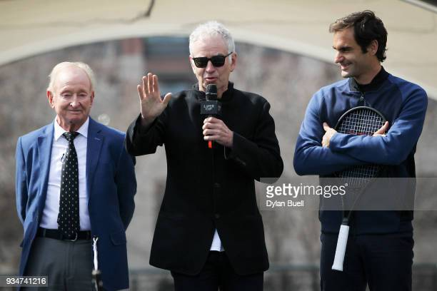 John McEnroe speaks to the crowd as Rod Laver and Roger Federer of Switzerland look on during the Laver Cup 2018 Chicago Launch at Cloud Gate on...