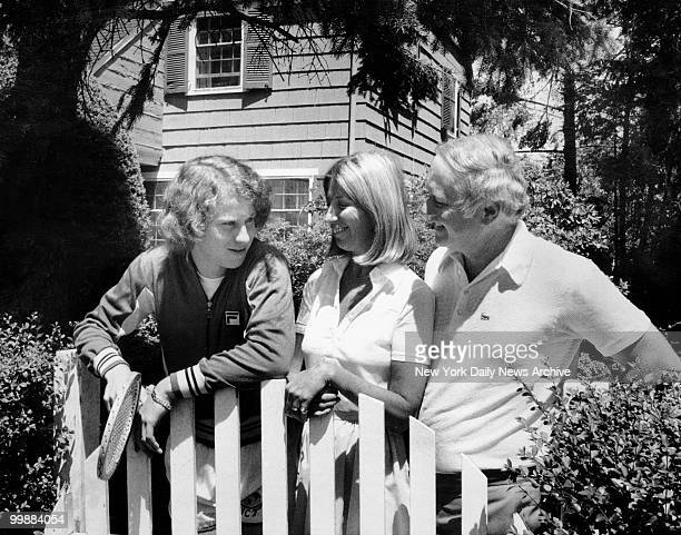 John McEnroe talks with parents Kay McEnroe and John McEnroe Sr outside their home in the Douglaston community in the New York City borough of Queens...