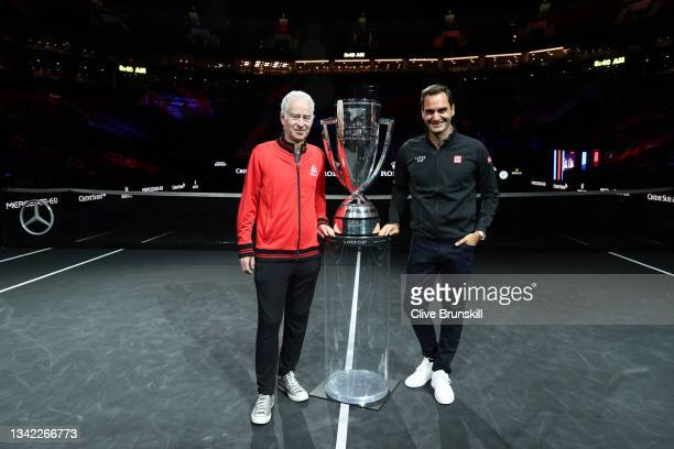 John McEnroe Team World Captain and Roger Federer pose for a photograph with the Laver Cup Trophy after taking part in a live TV interview on CNBC at...