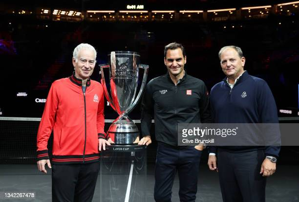 John McEnroe Team World Captain, Roger Federer and Tony Godsick Laver Cup Chairman pose for a photograph with the Laver Cup Trophy after taking part...