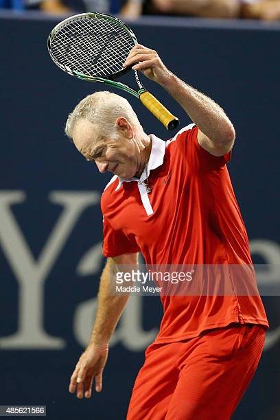 John McEnroe tosses his racket during his match against Jim Courier as part of the Men's Legends presented by PowerShares Series at the Connecticut...