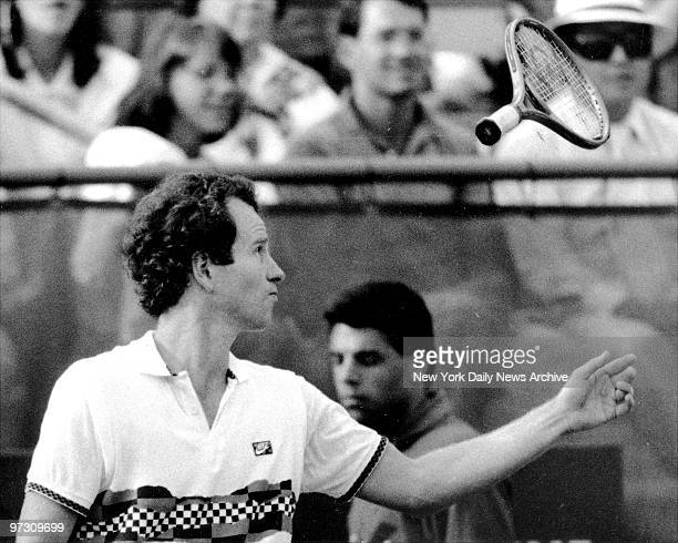 John McEnroe tosses racket over shoulder in disgust with linesman's bad call during his 5 set victory over Zivojinovic Mac was penalized a point and...