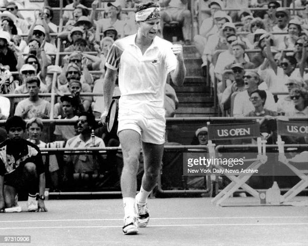 John McEnroe, urges himself on during five-set victory over Emilio Sanchez in fourth-round of the U.S. Open. McEnroe won the fifth and deciding set,...