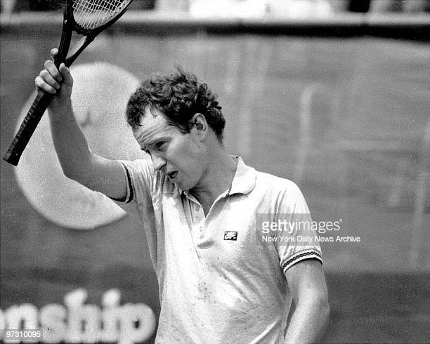 John McEnroe wipes away perspiration during match with Tomas Smid at US Open Tennis