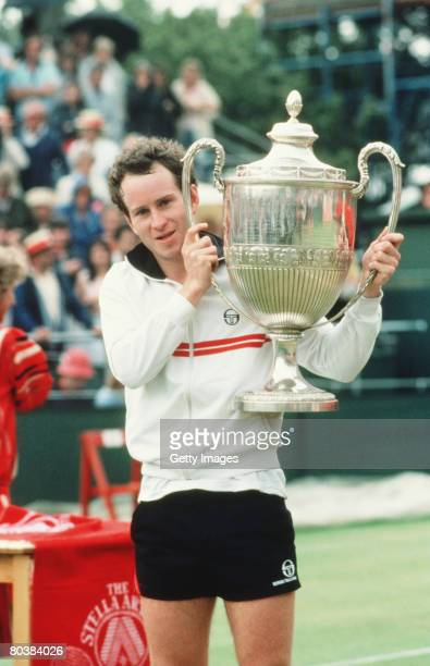 John McEnroe with the trophy at the Stella Artois Tennis Championship held at the Queen's Club in London England