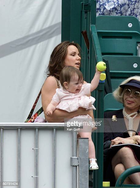 John McEnroe's daughter Ava throughs dad a tennis ball during the match at charity tennis event at Buckingham Palace for the National Society for the...