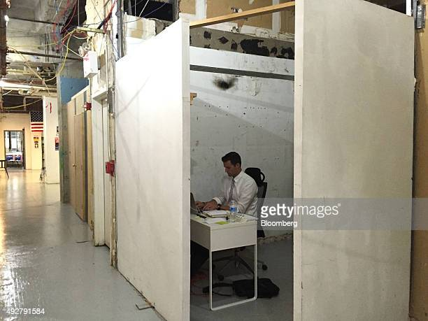 John McEntee a staffer for Donald Trump's 2016 Republican presidential campaign works at his desk inside the Trump campaign headquarters located in...