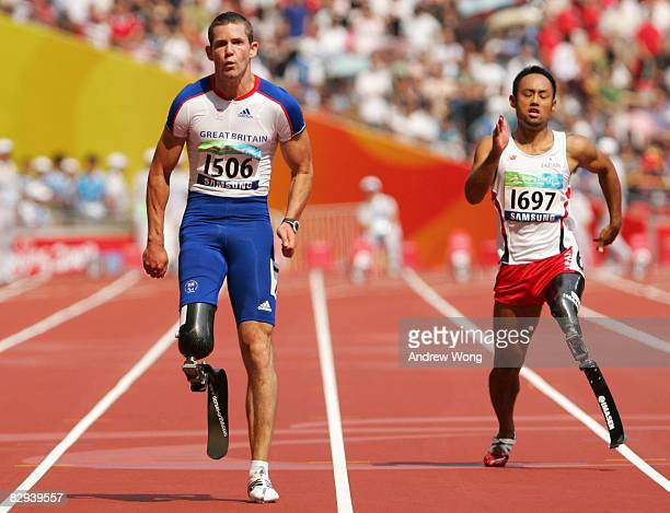 John McFall of Great Britain competes in the Men's 100m T42 Final Athletics event at the National Stadium during day eight of the 2008 Paralympic...
