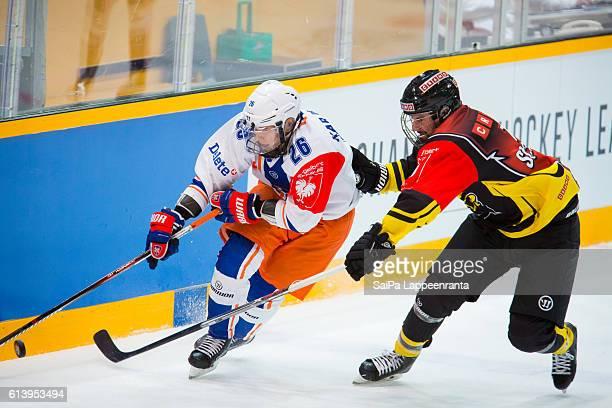 John McFarland of Lappeenranta challenges Jere Karjalainen of Tampere during the Champions Hockey League Round of 32 match between SaiPa Lappeenranta...