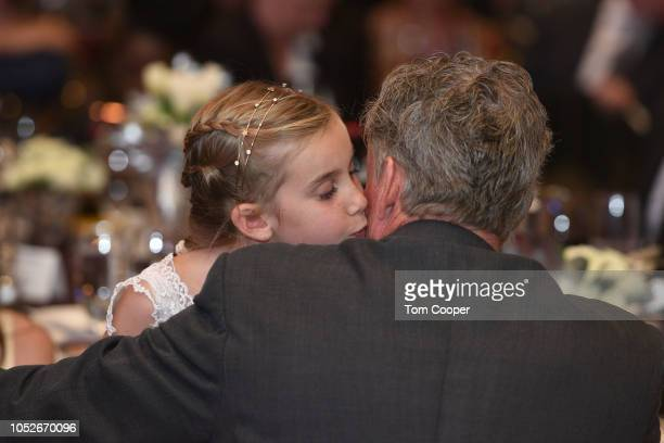 John McGinley gets kisses from his daughter Kate at the Global Down Syndrome Foundation 10th anniversary BBBY fashion show at Sheraton Denver...