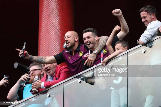 John McGinn and Alan Hutton of Aston Villa celebrate promotion to the Premier League from their hotel balcony in front of fans after the Sky Bet...
