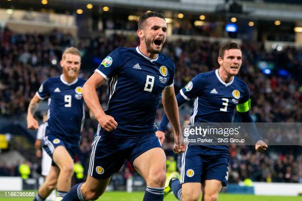John McGinn is pictured celebrating making it 1-0 to Scotland during the Euro 2020 qualifier between Scotland and Russia at Hampden Park, on...