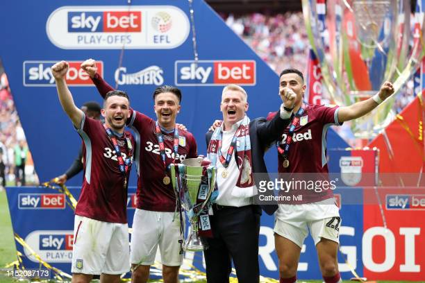 John McGinn Jack Grealish Dean Smith Manager of Aston Villa and Anwar El Ghazi of Aston Villa celebrate with the trophy following victory in the Sky...
