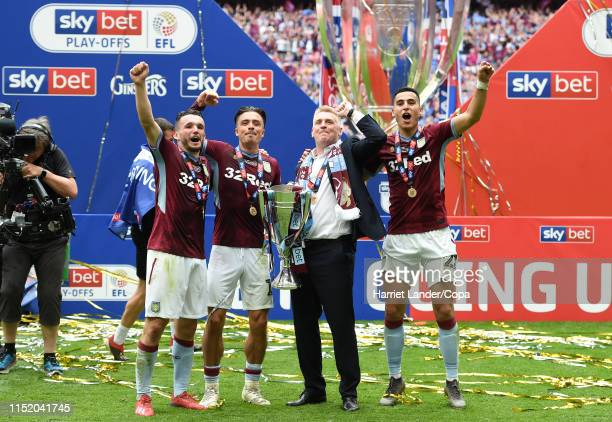 John McGinn, Jack Grealish, Dean Smith, Manager of Aston Villa, and Anwar El Ghazi of Aston Villa celebrate with the Sky Bet Championship Play-off...