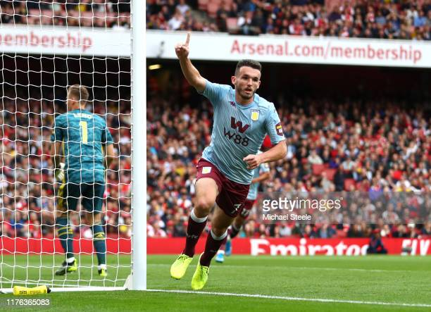 John McGinn of Aston Villa celebrates after scoring his team's first goal during the Premier League match between Arsenal FC and Aston Villa at...