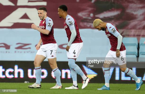 John McGinn of Aston Villa celebrates with Ezri Konsa after scoring their side's first goal during the Premier League match between Aston Villa and...