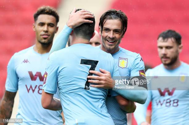 John McGinn of Aston Villa celebrates with Jack Grealish of Aston Villa after he scores his sides fourth goal during the PreSeason Friendly match...