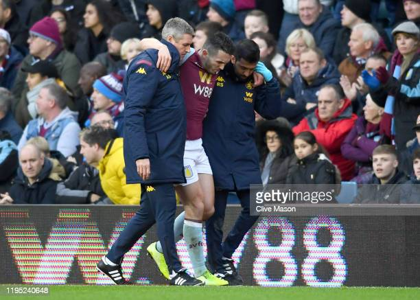 John McGinn of Aston Villa is helped off the pitch after picking up an injury during the Premier League match between Aston Villa and Southampton FC...