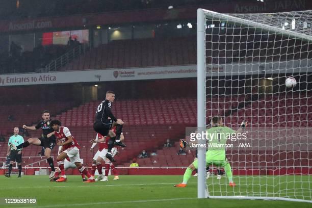 John McGinn of Aston Villa scores a goal to make it 0-1 during the Premier League match between Arsenal and Aston Villa at Emirates Stadium on...