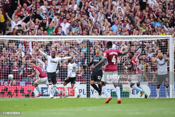John McGinn of Aston Villa scores a goal to make it 20 past goalkeeper Kelle Roos of Derby County during the Sky Bet Championship Playoff Final match...
