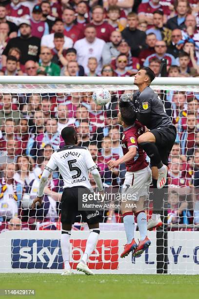 John McGinn of Aston Villa scores a goal to make it 2-0 past goalkeeper Kelle Roos of Derby County during the Sky Bet Championship Play-off Final...
