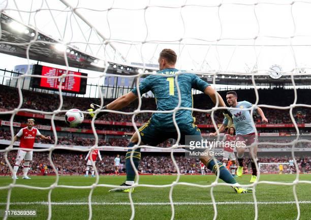 John McGinn of Aston Villa scores his team's first goal during the Premier League match between Arsenal FC and Aston Villa at Emirates Stadium on...