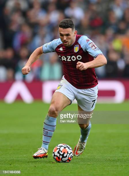 John McGinn of Aston Villa takes the ball forward during the Premier League match between Aston Villa and Wolverhampton Wanderers at Villa Park on...