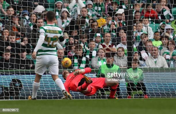 John McGinn of Hibernian's shot beats Craig Gordon of Celtic for his second during the Ladbrokes Scottish Premiership match between Celtic and...