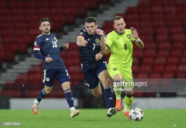 John McGinn of Scotland battles for possession with Vladimir Coufal of Czech Republic during the UEFA Nations League group stage match between...