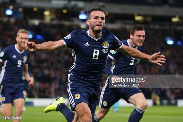 John McGinn of Scotland celebrates after scoring their first goal during the UEFA Euro 2020 qualifier between Scotland and Russia at Hampden Park on...