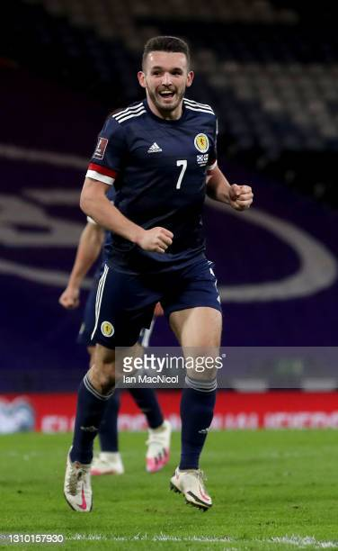 John McGinn of Scotland celebrates after scoring their team's second goal during the FIFA World Cup 2022 Qatar qualifying match between Scotland and...