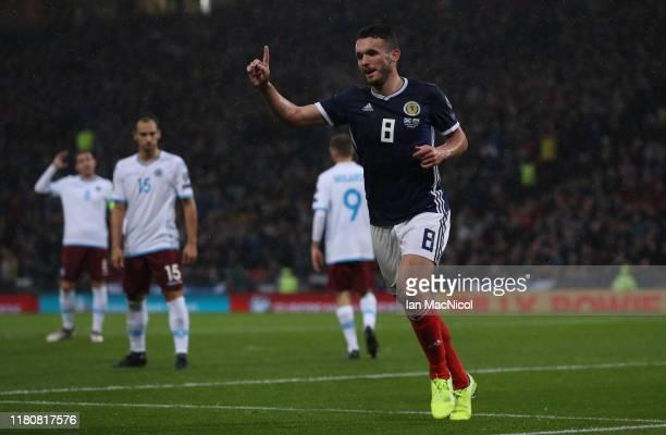 John McGinn of Scotland celebrates scoring the opening goal during the UEFA Euro 2020 qualifier between Scotland and San Marino at Hampden Park on...