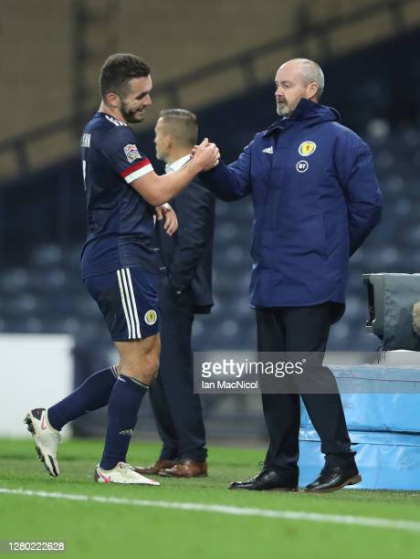 John McGinn of Scotland interacts with Steve Clarke Head Coach of Scotland as he walks off the pitch during the UEFA Nations League group stage match...