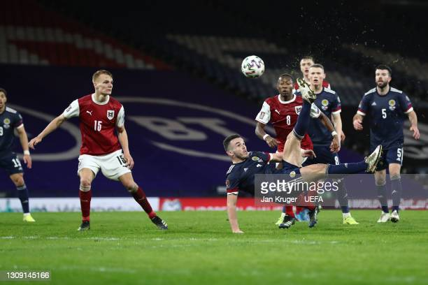 John McGinn of Scotland scores their side's second goal during the FIFA World Cup 2022 Qatar qualifying match between Scotland and Austria on March...