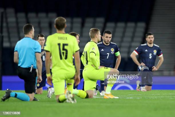 John McGinn of Scotland takes a knee in support of the Black Lives Matter movement during the UEFA Nations League group stage match between Scotland...