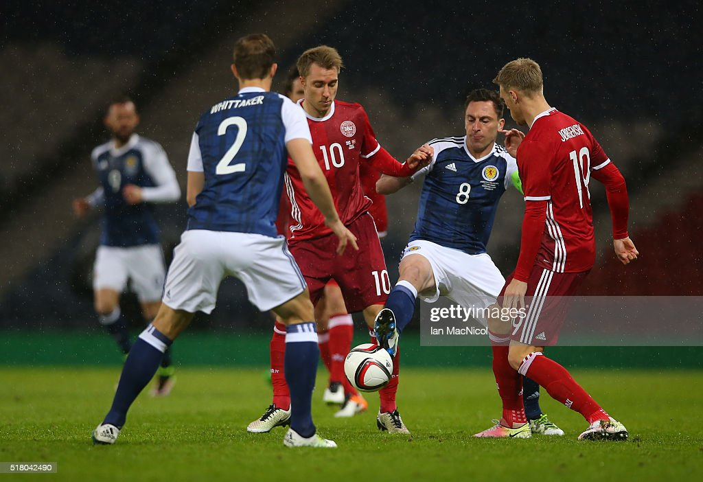 John McGinn of Scotland vies with Christian Eriksen of Denmark during the International Friendly match between Scotland and Denmark at Hampden Park on March 29, 2016 in Glasgow, Scotland.