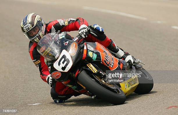 John McGuinness in action at CregnyBaa during the Bennetts Superbike race at the Isle of Man TT Races on Jun 4 2007 in Isle of Man