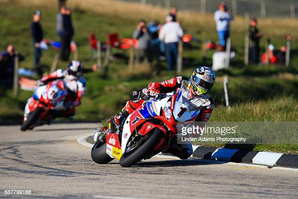 John McGuinness leads local Isle of Man rider Conor Cummins over the mountain during an evening practice at The Isle of Man TT Races on June 02 2016...
