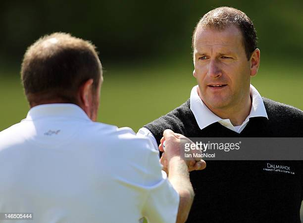 John McHardy and Alan Tait of Marriott Dalmahoy Golf and Country Club congratulate on another during the Virgin Atlantic PGA National Pro-Am...