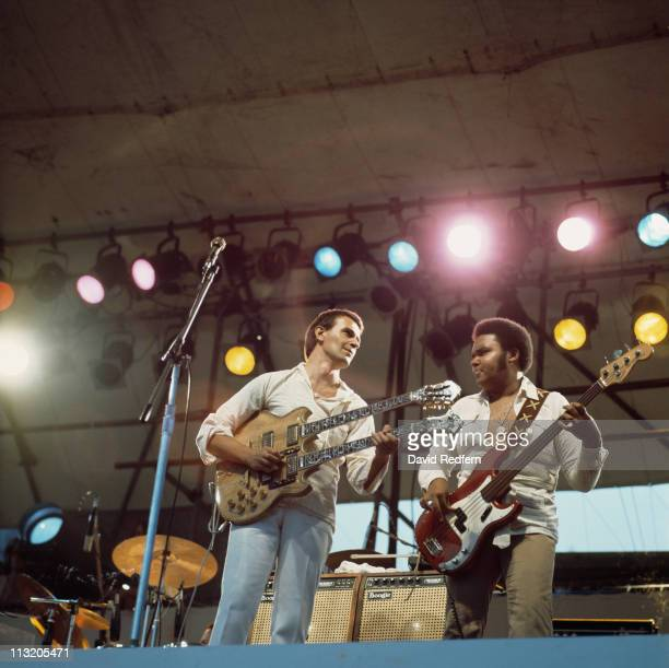 John McLaughlin, British jazz guitarist, playing a double-necked guitar, and and bassist Ralphe Armstrong during a live concert performance with the...